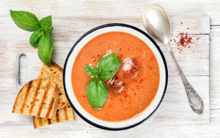 Picture of tomato gazpacho soup with basil.